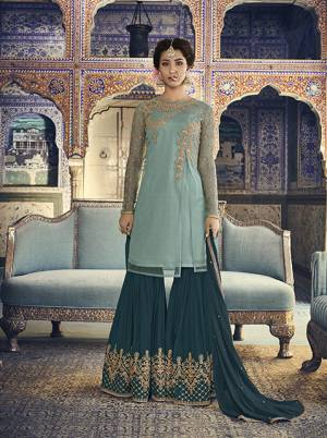 Go With The Shades Of Blue Which Suits Every Age Group, Be It A Mother Or Daughter. Its Top Is In Aqua Blue Color Paired With Teal Blue Colored Bottom And Dupatta. Its Top Is Fabricated On Net Paired With Georgette Bottom And Chiffon Dupatta. It Has Pretty Attractive Embroidery Over The Top And Bottom.