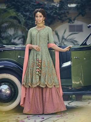 New And Unique Patterned Sharara Suit Is Here For You And Your Daighter In Light Green Colored Top Paired With Contrasting Pink Colored Bottom And Dupatta. Its Top Is Fabricated On Georgette Paired With Jacquard Silk Bottom And Chiffon Fabricated Dupatta.