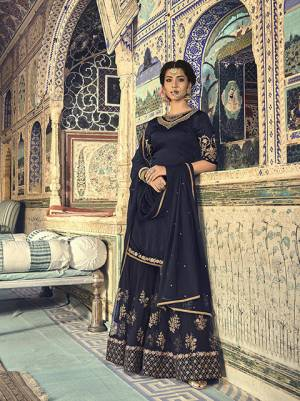 Enhance Your Personality In This Beautiful Designer Sharara Suit Availabe For You And Your Daughter In Navy Blue Color. Its Top Is Fabricated On Satin Georgette Paired With Net Fabricated Bottom And Dupatta. This Suit Also Ensures Superb Comfort And Easy To Carry Throughout The Gala.