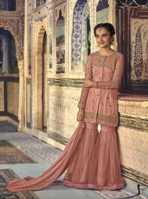A Must Have Shade In Every Age Group Womens Wardrobe Is Here With This Peach Colored Designer Sharara Suit. This Pretty Suit Is Fabricated On Net Paired With Chiffon Fabricated Dupatta. Grab This Sharara Suit For You And Your Daughter Which Will Definitely Earn You Guys Lots Of Compliments From Onlookers.