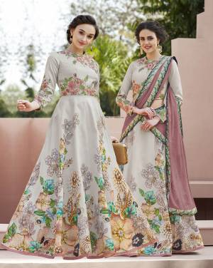 Grab This Designer Lehenga Choli For The Upcoming Festive And Wedding Season. This Lehenga Choli Is Fabricated On Satin Silk Paired With Chiffon Silk Dupatta. It Is Beautified Bold Floral Digital Prints And Thread Embroidery with Stone Work. Its Fabrucs Ensures Superb Comfort All Day Long. Buy Now.