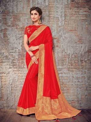 Wear this red and gold color silk fabrics saree. Ideal for party, festive & social gatherings. this gorgeous saree featuring a beautiful mix of designs. Its attractive color and designer heavy design, stone design, silk art and beautiful design all over work over the attire & contrast hemline adds to the look. Comes along with a contrast unstitched blouse.