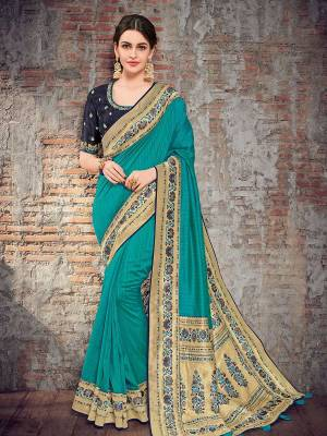 Presenting This Blue color two tone silk fabrics saree. Ideal for party, festive & social gatherings. this gorgeous saree featuring a beautiful mix of designs. Its attractive color and designer heavy design, stone design, silk art design and beautiful design all over work over the attire & contrast hemline adds to the look. Comes along with a contrast unstitched blouse.