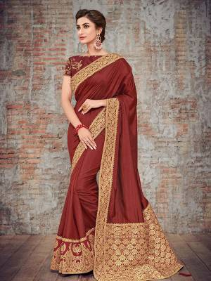 marvelously charming is what you will look at the next wedding gala wearing this beautiful maroon color two tone silk fabrics saree. Ideal for party, festive & social gatherings. this gorgeous saree featuring a beautiful mix of designs. Its attractive color and designer heavy design, silk art design and beautiful design all over work over the attire & contrast hemline adds to the look. Comes along with a contrast unstitched blouse.