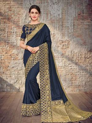 Bring out the best in you when wearing this Navy Blue color two tone silk fabrics saree. Ideal for party, festive & social gatherings. this gorgeous saree featuring a beautiful mix of designs. Its attractive color and designer heavy design, stone design, silk art design and beautiful design all over work over the attire & contrast hemline adds to the look. Comes along with a contrast unstitched blouse.
