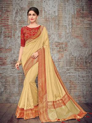 Look gorgeous in this beautiful printed beige color silk fabrics saree. Ideal for party, festive & social gatherings. this gorgeous saree featuring a beautiful mix of designs. Its attractive color and designer heavy design, stone design, silk art design and beautiful design all over work over the attire & contrast hemline adds to the look. Comes along with a contrast unstitched blouse.