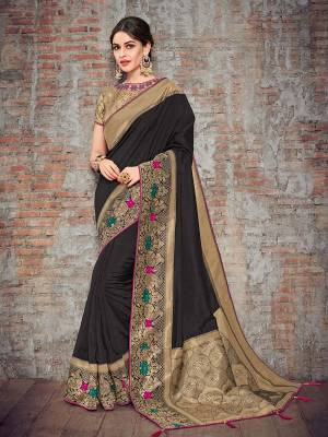 The fabulous pattern makes this saree a classy number to be included in your wardrobe. black and golden color silk fabrics saree. Ideal for party, festive & social gatherings. this gorgeous saree featuring a beautiful mix of designs. Its attractive color and designer heavy design, stone design, silk art design and beautiful design all over work over the attire & contrast hemline adds to the look. Comes along with a contrast unstitched blouse.