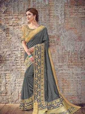 Bring out the best in you when wearing this grey color two tone silk fabrics saree. Ideal for party, festive & social gatherings. this gorgeous saree featuring a beautiful mix of designs. Its attractive color and designer heavy design, stone design, silk art design and beautiful design all over work over the attire & contrast hemline adds to the look. Comes along with a contrast unstitched blouse.