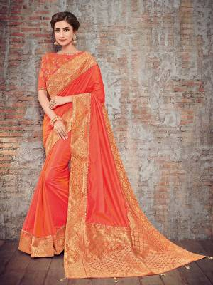 Vibrant and visually appealing, this Orange color two tone silk fabrics saree. Ideal for party, festive & social gatherings. this gorgeous saree featuring a beautiful mix of designs. Its attractive color and designer heavy design, stone design, silk art design and beautiful design all over work over the attire & contrast hemline adds to the look. Comes along with a contrast unstitched blouse.