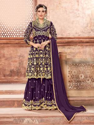 This Festive Season, Grab This Heavy Designer Sharara Suit In Purple Color Paired With Purple Colored Bottom And Dupatta. Its Heavy Embroidered Top And Bottom Are Fabricated On Satin Georgette Paired With Chinon Fabricated Dupatta. Buy This Semi-Stitched Suit Now.