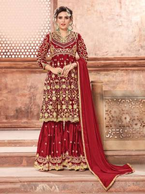 This Festive Season, Grab This Heavy Designer Sharara Suit In Red Color Paired With Red Colored Bottom And Dupatta. Its Heavy Embroidered Top And Bottom Are Fabricated On Satin Georgette Paired With Chinon Fabricated Dupatta. Buy This Semi-Stitched Suit Now.