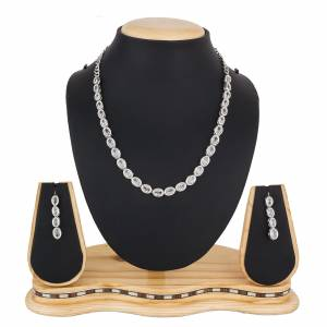 Give A Rich And Elegant Look To Your Neckline With This Designer Necklace Set In Silver Color Beautified With Attractive Stone Work, You Can Pair This Up With Any Colored Indian Or Western Attire.