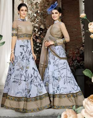 Grab This Designer Semi-Stitched Lehenga Choli And Get This Altered As Per Your Occasion, You Can Set This Stitched As A Suit Or Lehenga Choli. Its Blouse Is Fabricated On Art Silk And Net Paired With Orgenza Lehenga And Net Fabricated Dupatta, Buy This Two In One Semi-Stitched Lehenga Choli Now.