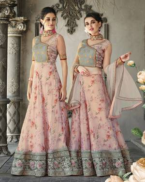 Here Is A Designer Lehenga Choli For The Upcoming Festive And Wedding Season. This Designer Lehenga Choli Can Be Stitched As A Floor Length Suit As Per Your Occasion. Its Blouse Is Fabricated On Art Silk And Net Paired With Oragenza Fabricated Floral Printed Lehenga And Net Fabricated Dupatta. Buy This Now.