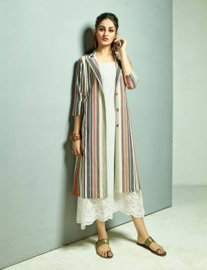 Grab This Designer Patterned Readymade Kurti In White Color Paired With A Very Smart Multi Colored Jacket. This Top And Jacket Are Fabricated On Cotton Beautified With Prints And Thread Work.