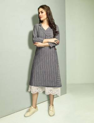 Rich And Elegant Looking Designer Readymade Kurti IS Here In White Colored Top Paired With Grey Colored Jacket. Its Top And Jacket Are Cotton Based And Available In All Sizes. It IS Suitable For Your Semi-Casuals, Festive Wear Or As Formal Wear. Buy Now.