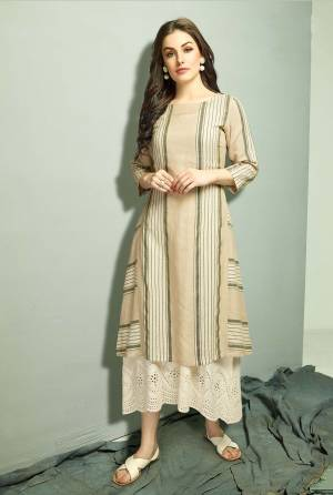 Flaunt Your Rich And Elegant Taste Wearing This Designer Readymade Kurti In Off-White Colored Top Paired With A Very Pretty Over Dress In Beige Color. Both The Top are Cotton Based Which Are Summer Friendly And Also Available In all Sizes.