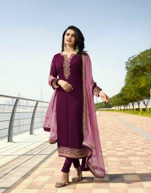 Add This Beautiful Designer Suit To your Wardrobe In Wine Colored Top And Bottom Paired With Powder Pink Colored Dupatta. Its Top Is Fabricated On Georgette Satin Paired With Santoon Bottom And Georgette Fabricated Dupatta. Its Top And Dupatta Are Beautified With Attractive Elegant Embroidery.