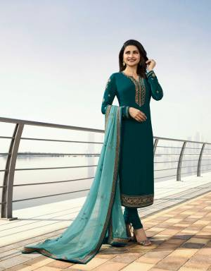New Shade In Blue Is Here With This Deisgner Straight Suit In Teal Blue Colored Top And Bottom Paired With Pretty blue Colored Dupatta. Its Top Is Fabricated On Georgette Satin Paired With Santoon Bottom And Georgette Dupatta.