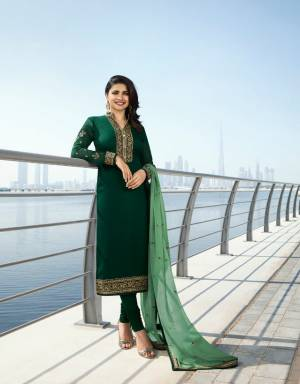 Grab This Beautiful Designer Straight Suit In Dark Green Color Paired With Green Colored Dupatta. Its Top Is Georgette Satin Based Paired With Santoon Bottom And Georgette Fabricated Dupatta. This Designer Suit Is Light In Weight And You can Get This Customised As Per Your Desired Fit And Comfort.