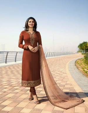 With Some New Color Pallete, Grab This Designer Straight Suit In Brown Color Paired With A Pretty Beige colored Dupatta. Its Top Is Fabricated On Georgette Satin Paired With Santoon Bottom and Georgette Fabricated Dupatta. All Its Fabrics Ensures Superb Comfort All Day Long.