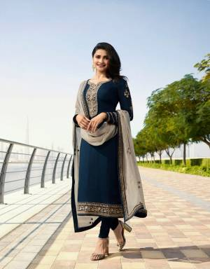 Enhance Your Personality Wearing This Designer Straight Suit In Navy Blue Color Paired With Contrasting Grey Colored Dupatta. Its Top Is Fabricated On Georgette Satin Paired With Santoon Bottom And Georgette Fabricated Dupatta. Its Rich And Elegant Color Combination Will Earn You Lots Of Compliments From Onlookers.