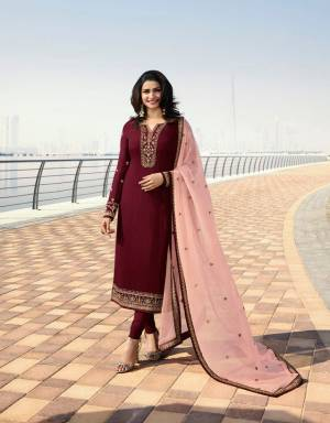 Here Is A Very Pretty Designer Straight Cut Suit In Maroon Color Paired With Contrasting Peach Colored Dupatta. Its Top Is Fabricated On Georgette Satin Paired With Santoon Bottom And Georgette Fabricated Dupatta. All Its Fabrics Are Light Weight And Easy To Carry All Day Long.