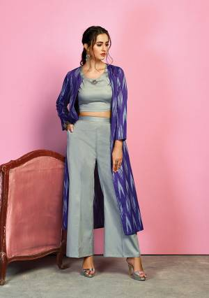 Enhance Your Personality In This Designer Indo Western Dress With Rich Color Pallete. Its Crop Top And Pants Are In Grey Color Paired With A Purple Colored Jacket. Its Top And Bottom Are Fabricated On Cotton Satin Paired With Handloom Cotton Printed Jacket.