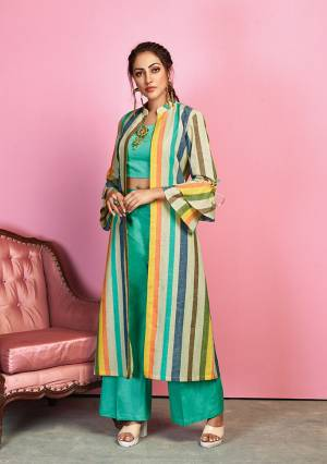 Go Colorful With This Designer Indo Western Dress In Sea Green Colored Crop Top And Pant Paired With Multi Colored Jacket. Its Top And Bottom Are Fabricated On Cotton Satin Paired With Handloom Cotton Fabricated Lining Printed Jacket.