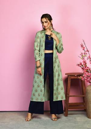 This Festive Season , Look The Most Unique Of All Wearing This Designer Indo-Western Dress In Navy Blue Colored Crop Top And Pant Paired With Light Green Colored Jacket. Its Top And Bottom Are Fabricated On Cotton Satin Paired With Handloom Cotton Jacket. It Is Light In Weight And Ensures Superb Comfort All Day Long.