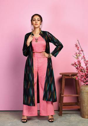 Look Pretty In This Lovely Indo-Western Pair In Pink Colored Crop Top And Pant Paired With Navy Blue Colored Jacket. Its Top And Bottom Are Fabricated On Cotton Satin Paired With Handloom Cotton Fabricated Jacket Beautified With Ikkat Prints.