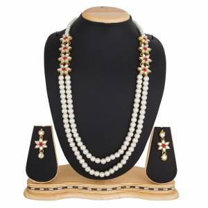 Grab This Very Pretty Pearl Necklace Set In White Color Beautified?With Stone Work. You Can Pair This Up With Same Or Any Contrasting Colored Traditional Attire. Buy Now