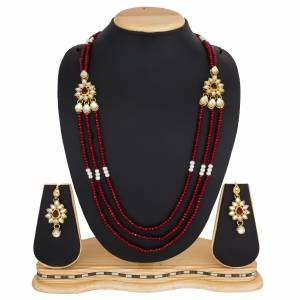 Grab This Very Pretty Pearl Necklace Set In Red Color Beautified?With Stone Work. You Can Pair This Up With Same Or Any Contrasting Colored Traditional Attire. Buy Now