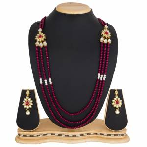 Grab This Very Pretty Pearl Necklace Set In Rani Pink Color Beautified?With Stone Work. You Can Pair This Up With Same Or Any Contrasting Colored Traditional Attire. Buy Now