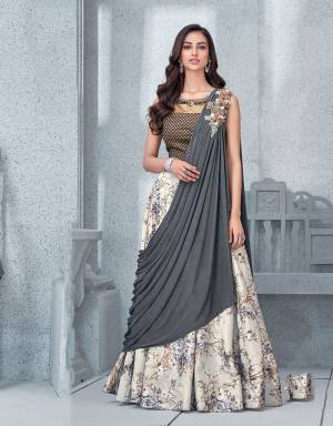 This floral printed lehenga is neutral and feminine yet speaks the language of the fashion like no other. The ready-to-wear sash dupatta is what makes this design intriguing.