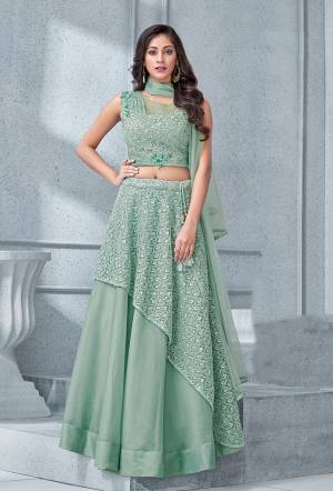 The pleats and patterns is the ultimate USP of this gorgeous pastel lehenga. The opulence and the details makes it an apt choice for the modern day princess