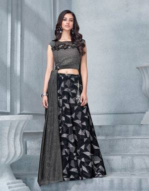 Encapsulate ladylike essence and make a statement with this glittering and glamourous lehenga with a stylish blouse design .