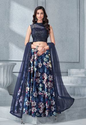 Adorn this lush botanical printed velvet lehenga that's all about enchanting vintage appeal. Add a pair of crystal earring and you are good to go.