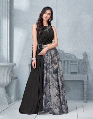 This magical blurred floral printed lehenga with an asymmetric blouse is an abolute tantalizing affair.
