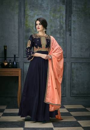 Enhance Your Personality Wearing This Designer Floor Length Suit In Navy Blue Colored Top And Bottom Paired With Contrasting Peach Colored Dupatta. Its Top IS Fabricated On Satin Georgette Paired With Santoon Bottom And Chiffon Dupatta. Buy Now.