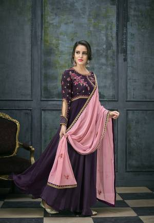 Look Pretty Wearing This Designer Floor Length Suit In Purple Colored Top And Bottom Paired With A Very Pretty Pink Colored Dupatta. Its Top Is Fabricated On Satin Georgette Paired With Santoon Bottom And Chiffon Fabricated Dupatta. This Suit Is Light In Weight And Easy To Carry All Day Long.