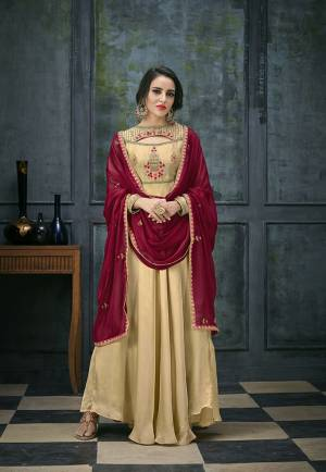 Flaunt Your Rich And Elegant Taste Wearing This Designer Floor Length Suit In Beige Colored Top And Bottom Paired With Maroon Colored Dupatta. Its Top Is Fabricated On Satin Georgette Paired With Santoon Bottom And Chiffon Dupatta. Its Fabrics Ensures Superb Comfort All Day Long.