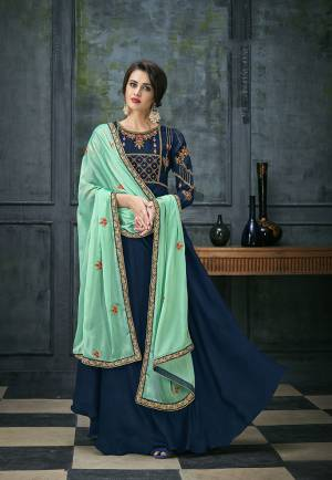 Bright And Visually Appealing Color Is Here With This Designer Floor Length Suit In Royal Blue Colored Top And Bottom Paired With Contrasting Sea Green Colored Dupatta. Its Top Is Fabricated On Satin Georgette Paired With Santoon Bottom And Chiffon Dupatta.