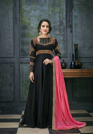 For A Bold And Beautiful Look, Grab This Designer Floor Length Suit In Black Color Paired With Pretty Fuschia Pink Colored Dupatta. Its Top Is Fabricated On Satin Georgette Paired With Santoon Bottom And Chiffon Fabricated Dupatta. Buy Now.
