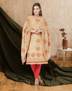 Here Is A Beautiful Embroidered Dress Material In Beige Colored Top and Dupatta Paired With Red Colored Bottom. Its Top And Bottom Are Cotton Based Paired With Chiffon Fabricated Dupatta. Buy Now.