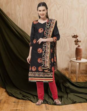 Here Is A Beautiful Embroidered Dress Material In Black Colored Top and Dupatta Paired With Red Colored Bottom. Its Top And Bottom Are Cotton Based Paired With Chiffon Fabricated Dupatta. Buy Now.