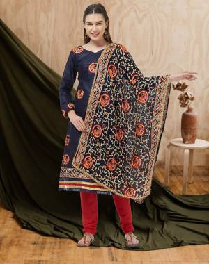 Here Is A Beautiful Embroidered Dress Material In Navy Blue Colored Top and Dupatta Paired With Red Colored Bottom. Its Top And Bottom Are Cotton Based Paired With Chiffon Fabricated Dupatta. Buy Now.