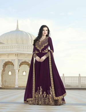 A Must Have Shade In Every Womens Wardrobe Is Here With This Designer Floor Length Suit In Wine Color Paired With Wine Colored Bottom And Dupatta. Its Embroidered Top And dupatta Are Fabricated On Georgette Paired With Santoon Fabricated Bottom. Buy Now.