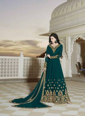 New Shade Is Here To Add Into Your Wardrobe With This designer Floor Length Suit In Teal Green Color Paired With Teal Green Colored Bottom And Dupatta. Its Top And Dupatta Are Georgette Based Paired With Santoon Fabricated Bottom. Buy Now.
