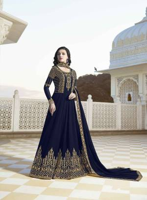 EnhanceYour Personality Wearing This Designer Floor Length Suit In Navy Blue Color Paired With Navy Blue Colored Bottom And Dupatta. Its Top And Dupatta Are Georgette Based Paired With Santoon Fabricated Bottom.